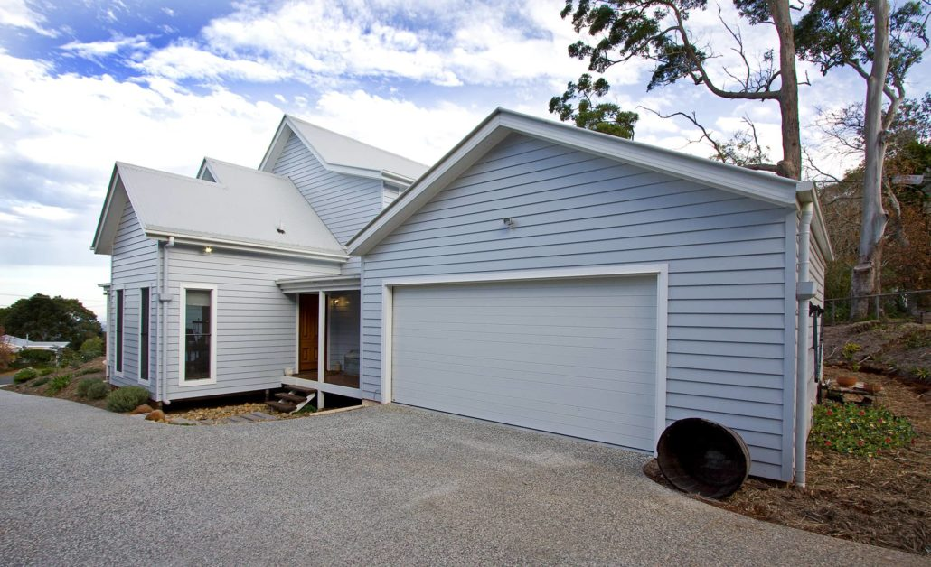 Cape cod style home in mount tamborine traditional for Weatherboard garage designs
